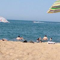 Photo taken at Akkum Plajı by Gulcin P. on 7/7/2012