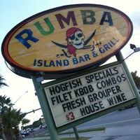 Photo taken at Rumba Island Bar & Grill by Tom K. on 9/10/2013
