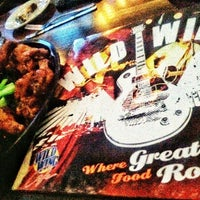 Photo taken at Wild Wing Cafe by Julie T. on 3/19/2014