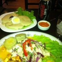 Photo taken at Kassai Café by Daniel E. on 9/30/2012