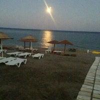 Photo taken at Ünlüselek Beach by Sedef A. on 9/9/2013