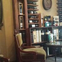 Photo taken at Porto coffee & wine by Zuzanna M. on 4/4/2014