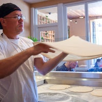 Photo taken at Amici's East Coast Pizzeria by Amici's East Coast Pizzeria on 7/13/2014