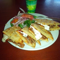 Photo taken at Lezzet Döner by Beyhan S. on 10/8/2013