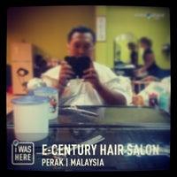Photo taken at E-Century Hair Salon by Fandi P. on 4/25/2013