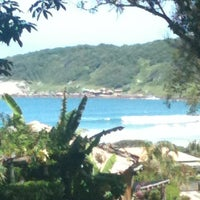 Photo taken at Praia do Rosa by Paula G. on 1/1/2013