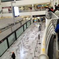 Photo taken at Terminal 1 by Fernando A. on 2/1/2013