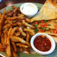 Photo taken at Swiss Chalet by Chris T. on 2/2/2013