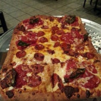 Photo taken at Brozinni Pizzeria by Angel L. on 10/2/2013