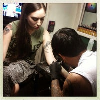 Photo taken at Inkin' Ian Tattoo by Naomi B. on 9/16/2013