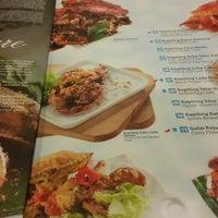 Photo taken at Rasane Seafood & Ikan Bakar by Yuliana S. on 7/8/2014