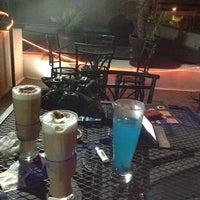 Photo taken at Luna Café by Luis C. on 5/2/2014