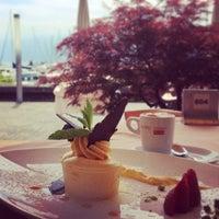 Photo taken at Restaurant du Port de Pully by Alexandra K. on 6/14/2014