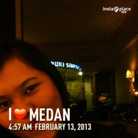 Photo taken at Madani Hotel by Theresia Lasma L. on 2/12/2013