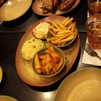 Photo taken at Nando's by Gygie B. on 12/18/2013