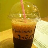 Photo taken at 커피지인 by Sanghee J. on 6/5/2013