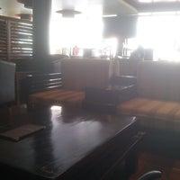 Photo taken at Bourbon Coffee by Abraham B. on 10/21/2013