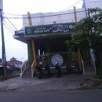 Photo taken at Pecel Lele Lela by Ujang T. on 12/25/2012