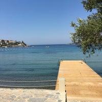 Photo taken at Balyek Beach by Emre on 7/13/2016