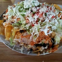 Photo taken at Sabor Latin Street Grill by Ryan D. on 12/3/2015