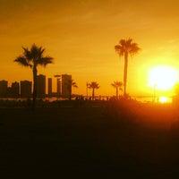 Photo taken at Playa Cavancha by Manuel V. on 3/4/2014