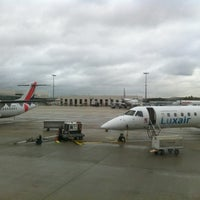 Photo taken at Gate G30 by Dominique A. on 11/2/2013