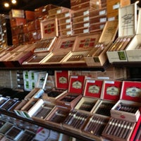 Photo taken at Corona Cigar Company & Drew Estate Lounge by Albert C. on 11/17/2012
