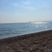 Photo taken at Gümüldür Özdere Beach by Dilek D. on 6/30/2016