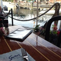 Photo taken at Shuckers Raw Bar by Bob T. on 7/9/2014