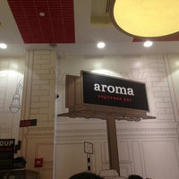Photo taken at Aroma Espresso Bar by Justin D. on 6/10/2013