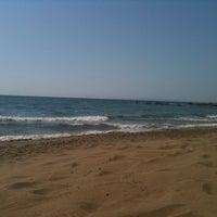Photo taken at Mare Dei Beach by Athanasios K. on 7/6/2012