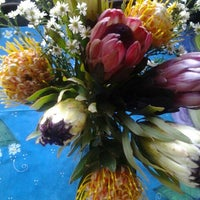 Photo taken at Trafalgar Place Flower Market by Stephan v. on 8/23/2014