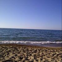 Photo taken at Пляж by Alina A. on 6/30/2014