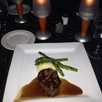 Photo taken at Atlantic Grille at Hammock Beach by Pam N. on 7/28/2013