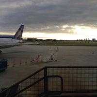 Photo taken at Gate A5 by Jon B. on 10/20/2012