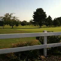 Photo taken at Bay Breeze Golf Course by Carrie S. on 8/2/2014