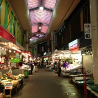 Photo taken at Omicho Market by hiroshi n. on 5/16/2013