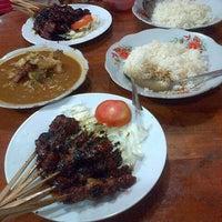 Photo taken at Warung Tongseng Pak Min by Aila H. on 12/28/2012