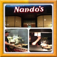 Photo taken at Nando's by A.G.T on 12/10/2012