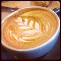 Photo taken at Artifact Coffee by Tom R. on 6/30/2013