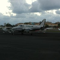Photo taken at Fernando Luis Ribas Dominicci Airport (SIG) by Gregory G. on 1/19/2013