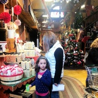 Photo taken at Yankee Candle Flagship Store by Christopher M. on 12/7/2013