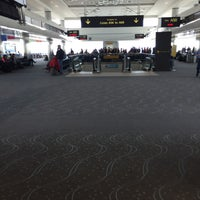 Photo taken at Gate A51 by Christina on 3/3/2016