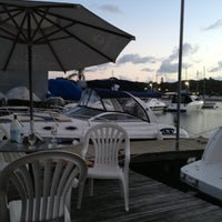 Photo taken at Marina Ponta da Areia Bar e Restaurante by Edna B. on 11/14/2012