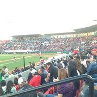 Photo taken at Estadio Gasmart by Ricardo A. on 5/26/2013