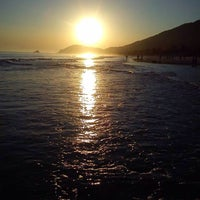 Photo taken at Praia de Juquehy by Jo M. on 9/13/2013