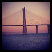 Photo taken at Ponte Vasco da Gama by Zé Renato C. on 9/15/2012