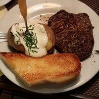 Photo taken at Farmer's Steakhouse by Irina K. on 1/3/2014