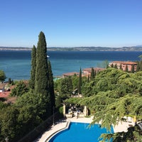 Photo taken at Villa Cortine Palace Hotel by Mikhail B. on 8/26/2014