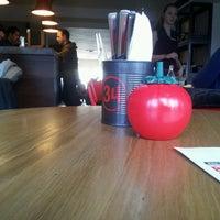 Photo taken at Gourmet Burger Kitchen by Viktorija J. on 2/22/2014